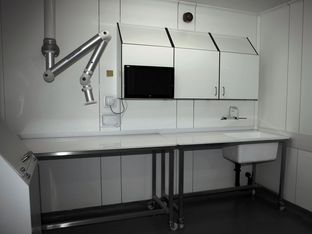 Necropsy room fitted with fume extraction and computer systems.